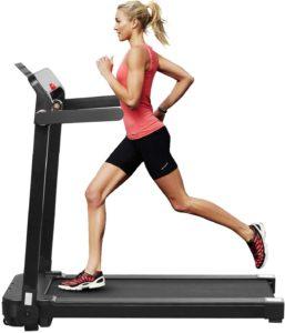 A woman intensely running on ZENOVA treadmill to burn her calories