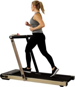 A Blond hair girl running on ASUNA Treadmill