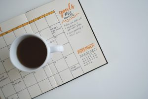 schedule and coffee cup