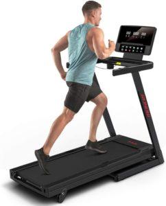 A man intensely running on the RUNOW treadmill