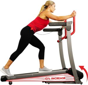 A woman in red shirt is climbing Treadmill