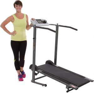 A girl standing besides the treadmill