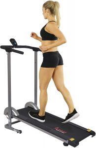 A girl running on a Sunny Health manual treadmill