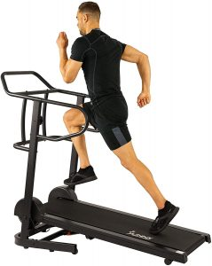 A man running intensely on the treadmill