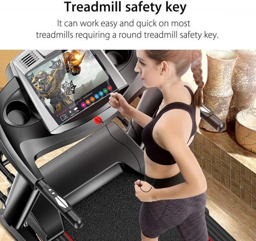A girl is jogging on treadmill with safety key attached